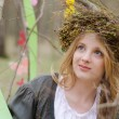 Close up portrait of a pretty smiling girl in a folk   circlet o — Stock Photo #44184165
