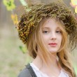 Close up portrait of a pretty pensive girl in a folk   circlet o — Stock Photo #44184251