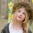 Close up portrait of a pretty pensive girl in the circlet of flo — Stock Photo #44185261