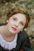 Close up portrait of a vintage style girl with dragonflies in he — Stock Photo