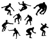 Silhouettes of surfers — Stock Photo