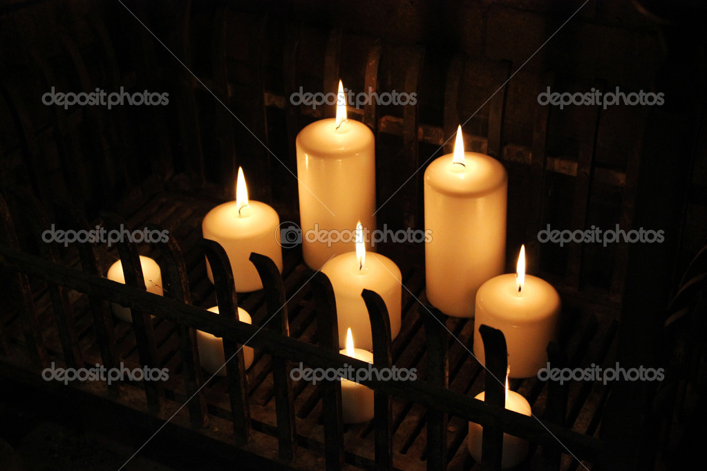 Lit candles in a fireplace  Stock Photo #13820735