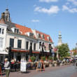 Old houses and restaurant on the street in Middelburg - Stock Photo