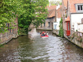 Channels, boat and houses of Bruges. — Stock Photo