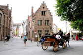 Horse Carriage and old houses in Bruges — Stock Photo