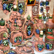 Foto Stock: Decorative clay plates cups and jugs decorated with blue grapes Moldova