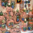 Stock Photo: Decorative clay plates cups and jugs decorated with blue grapes Moldova