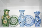 Vases and plates of blue and green decorated in the style of the Moldavian — Stock Photo