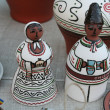 Clay figures of men and women in the Moldovan national costumes — Stok fotoğraf