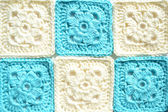 Knitted squares — Stock Photo