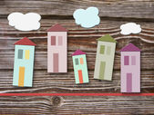 Colorful homes on wooden background — Stockfoto