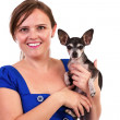 Portrait of a young woman holding her chihuahua dog — Stock Photo