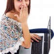 Portrait of a surprised young woman with laptop looking up — Stock Photo #18808827