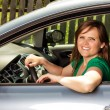 Pretty young woman driving  her car — Stock Photo