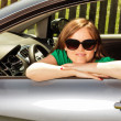 Closeup of a pretty young woman in her new car — Stock Photo