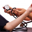 Doctor taking young womblood pressure — Stock Photo #27276325