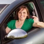Beautiful young woman showing her car keys — Stock Photo