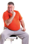 Overweight man showing his strength after doing exercises seted — Stock Photo