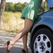 Woman standing by her broken car — Stock Photo #28098371