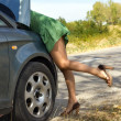 Woman standing by broken car — Stock Photo #28098375
