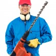 Worker holding a power drill — Stock Photo