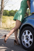 Woman standing by her broken car — Stock Photo