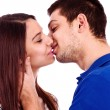 Foto Stock: Close up portrait of a romantic young couple kissing
