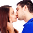 Close up portrait of a romantic young couple kissing — Foto Stock