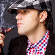 Stock Photo: Closeup of msmoking pipe