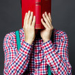 Portrait of mcovering his face with book — Stock Photo #28108253