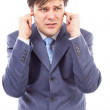 Young businessman with fingers in his ears protecting himself f — Stock Photo #28108331