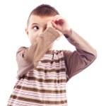 Cute little boy making an imaginary binocular with hands — Stock Photo