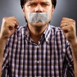 Stock Photo: Angry young mwith duct tape over his mouth
