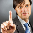 Businessman pressing an imaginary button — Stock Photo