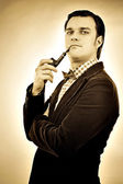Retro portrait of a gentleman smoking pipe — Stock Photo