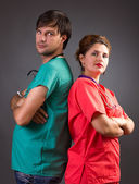 Serious team of two doctors standing back to back with arms fold — Photo