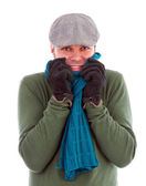Young man with gloves and scarf shivering from cold — Stock Photo