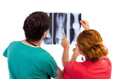 Two doctors having medical consultation of x-ray image. — Stock Photo