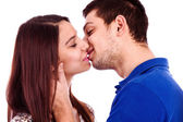 Close up portrait of a romantic young couple kissing — Stock Photo