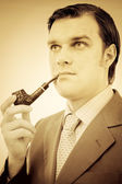 Portrait of a gentleman smoking pipe — Stock Photo