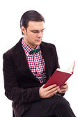 Portrait of a young gentleman reading a book — Stock Photo