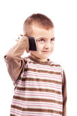 Adorable little boy using mobile phone — Stock Photo