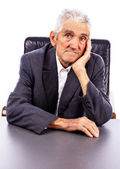 Portrait of a serious elderly man looking at camera — Stock Photo