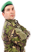 Closeup portrait of a young soldier with arms folded — Stock Photo
