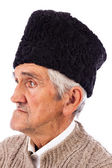 Portrait of a romanian old peasant with old fashion Astrakhan ha — Stock Photo