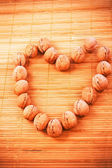 Walnuts forming hearth shape — Stock Photo