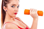 Closeup portrait of a pretty young woman exercising — Stock Photo