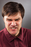 Closeup portrait of an angry man — Stock Photo