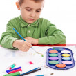 Cute little boy painting with brush — Stock Photo