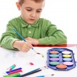 Cute little boy painting with brush — Stock Photo #28626145